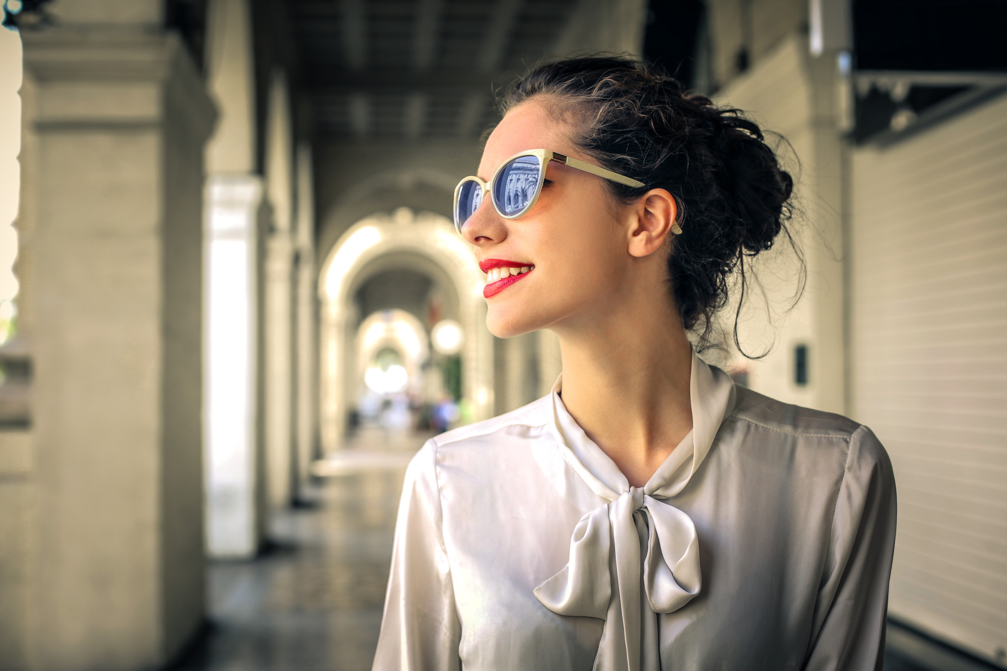 Fashionable woman walking in the city centre